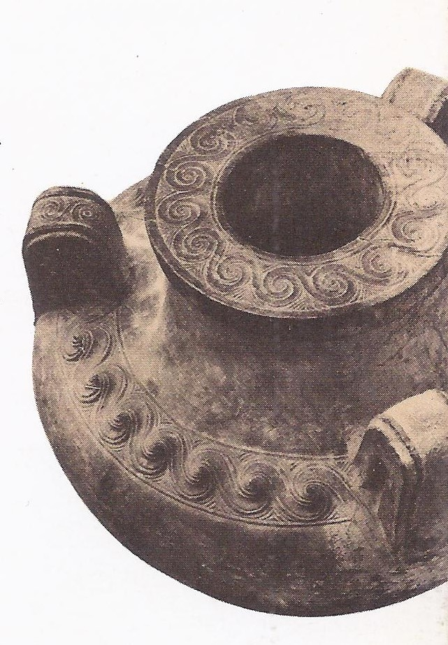 Patterns of Spirals are found on many Cretan artifacts of the Bronze Age and may have been the origin of the spiral patterns that became popular in Egypt c. 2000 B.C. Thus limestone amphora, from Knossos, dates from c. 1400 B.C. and is thus probably a little later than the Santorin eruption.