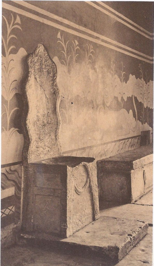 The alabaster throne o the rulers of Crete, in the throne room of the palace of Knossos. The frescoes on the wall behind are modern reconstructions carried out by Sir Arthur Evans.